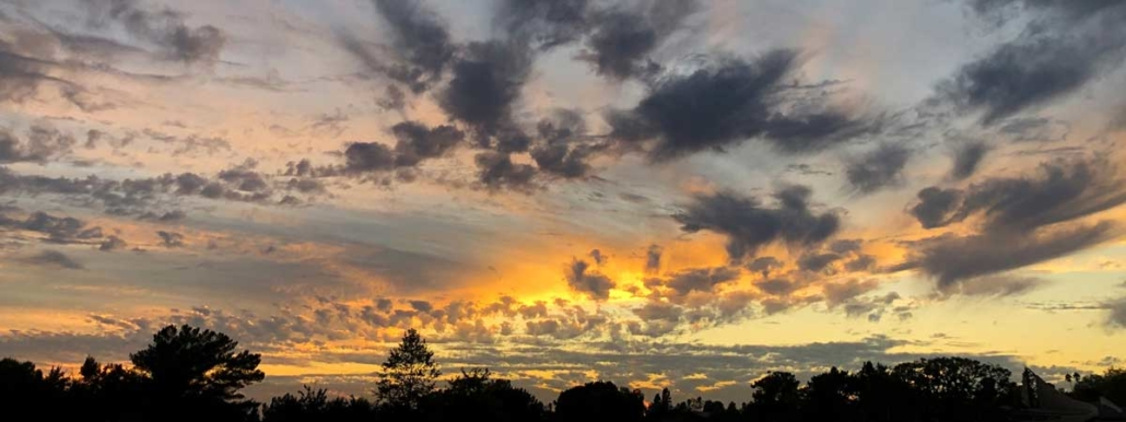 early morning sunrise with illuminated clouds